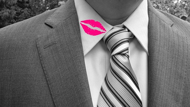 Man with a lipstick stain on his shirt collar