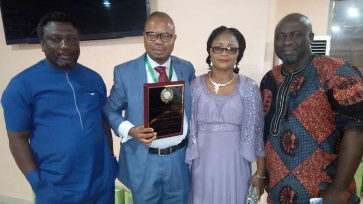 Left to right: Mr Festus, Mr. Usifoh Johnny, Mrs Usifoh Bose and Mr. Akinwale at the investiture of Mr. Usifoh as Fellow of the Institute of Human Resources and Strategic Management on Saturday