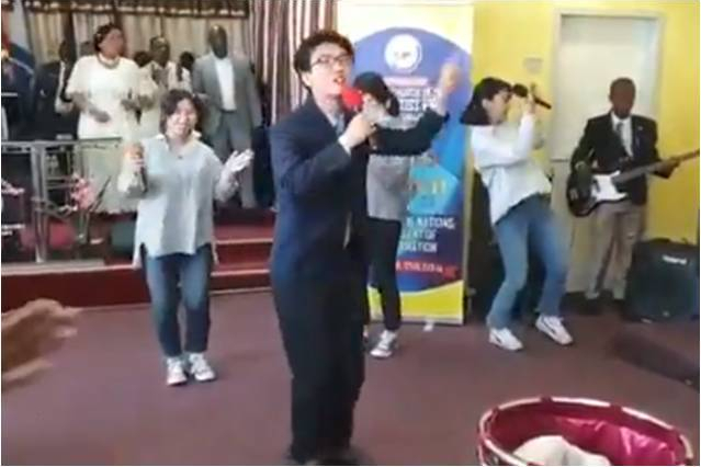 Chinese man leading praise and worship in a Nigeria church