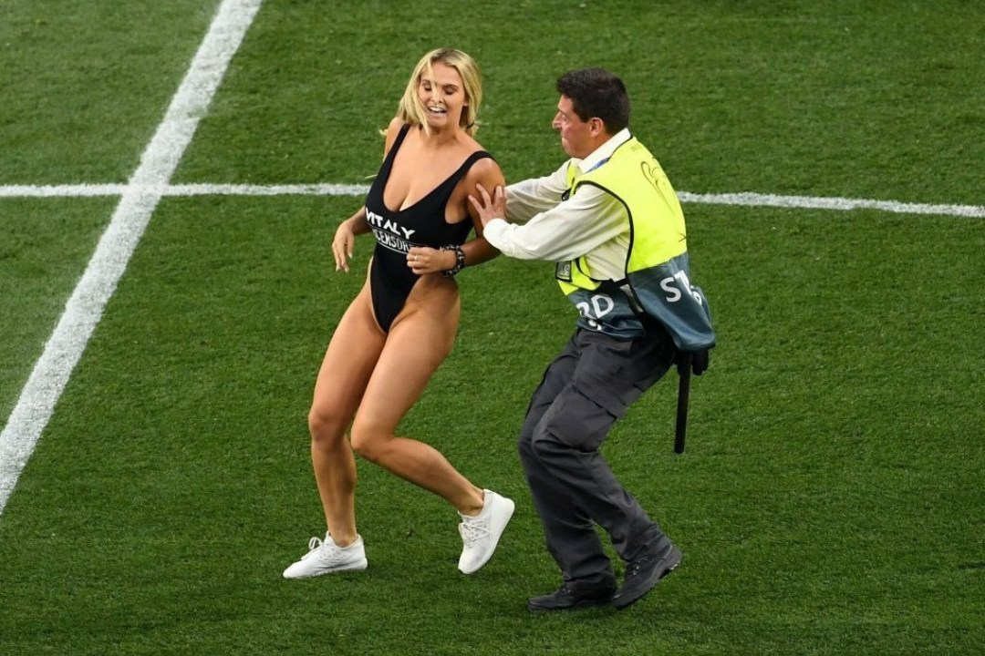Kinsey Sue stopped by a steward after she invaded the pitch at the Champions League Final Madrid.