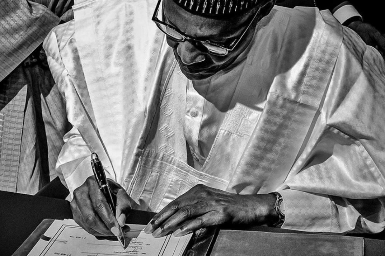 President Muhammadu Buhari of Nigeria signing a document