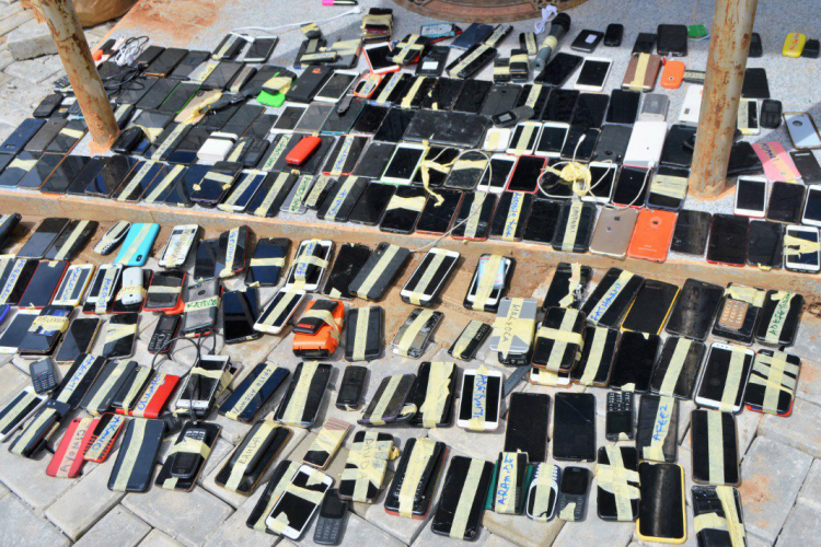Mobile phones and microphone confiscated from 94 persons accused of internet fraud by EFCC