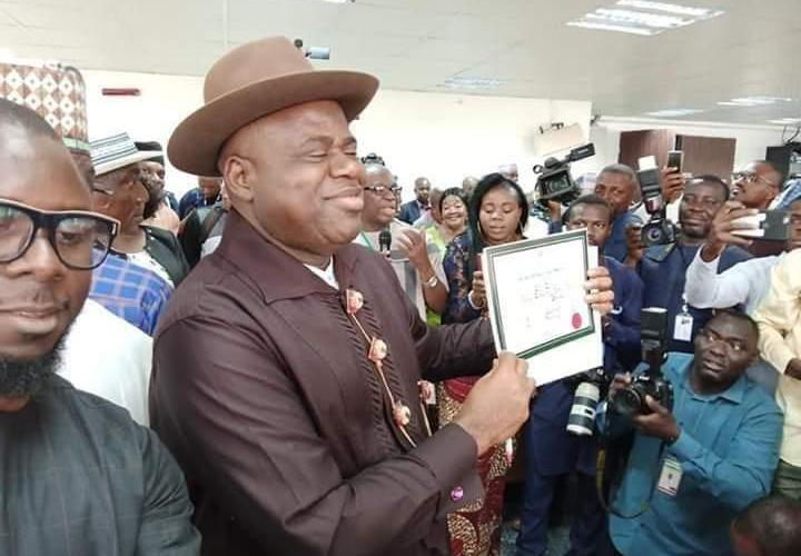 Senator Duoye Diri displaying his certificate of return issued to him by INEC as Governor of Bayelsa State